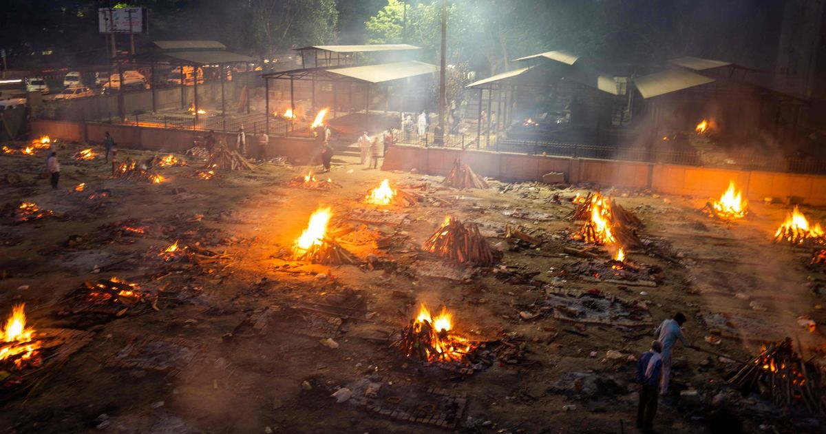 Makeshift funeral pyres burn bodies in parks as India's Covid crisis worsens
