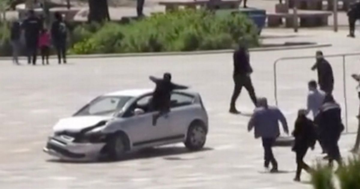 Man stops rampaging motorist in square with amazing flying kick through window