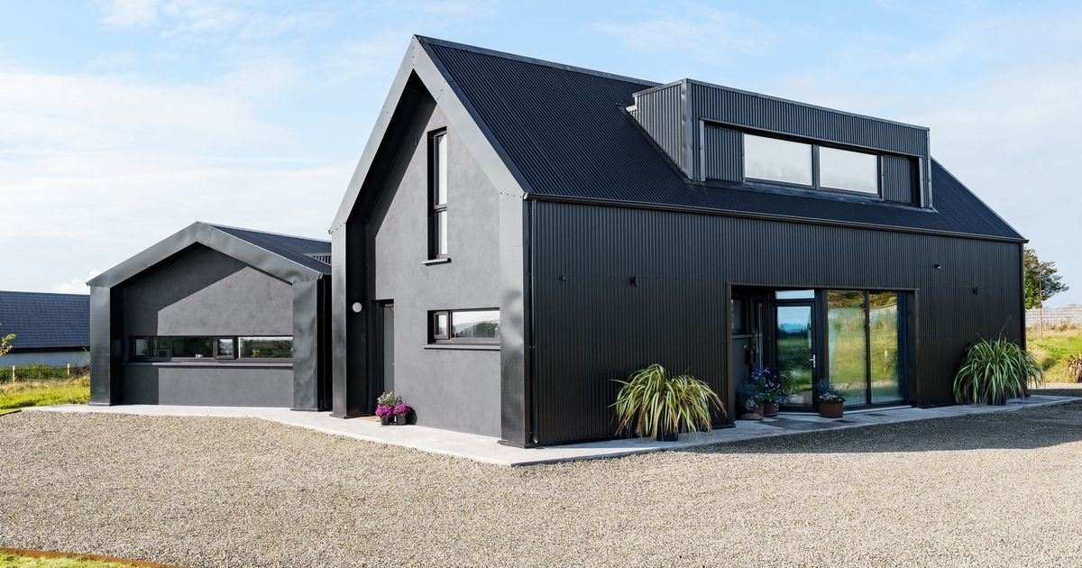 Man's 'black house' named top home of 2021 but people divided over use of piano