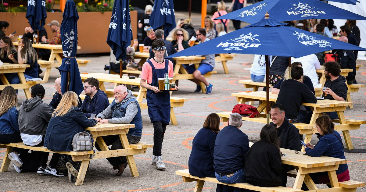 Pub gardens, outside dining and haircuts return in England as lockdown eases