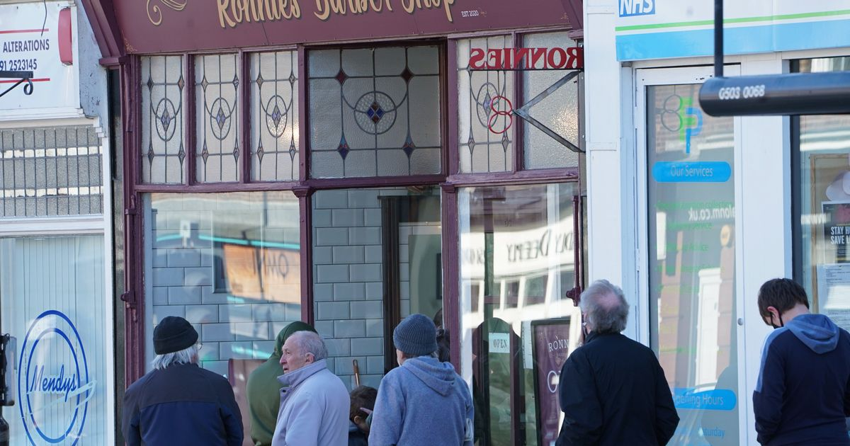 Queues at barbers, pubs and shops as lockdown lifts in England