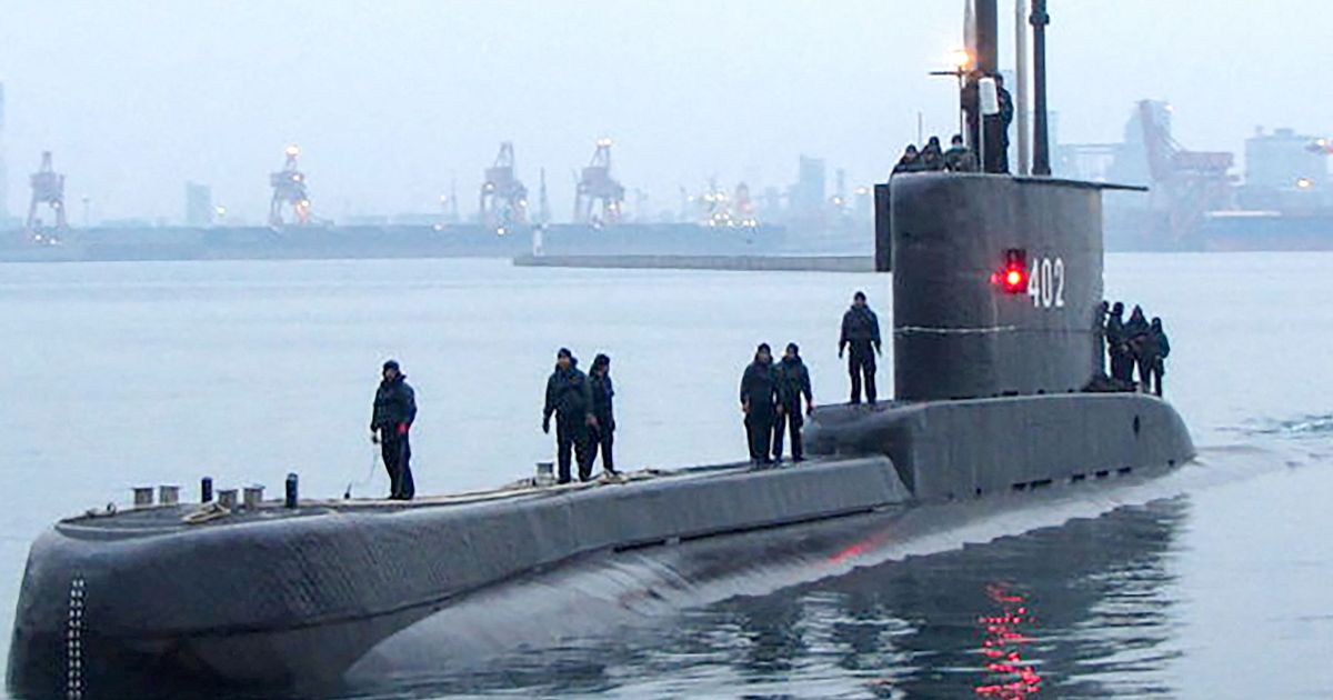 Rescuers find debris 'from missing submarine' as hopes fade for 53 crew