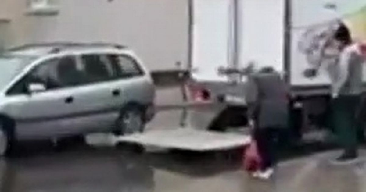 Heartwarming moment van driver saves elderly woman from stepping into a puddle
