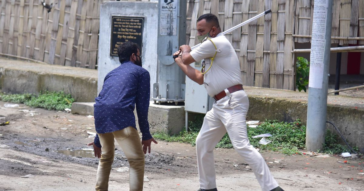 Police pictured 'beating' Covid rule breakers with batons in India clampdown