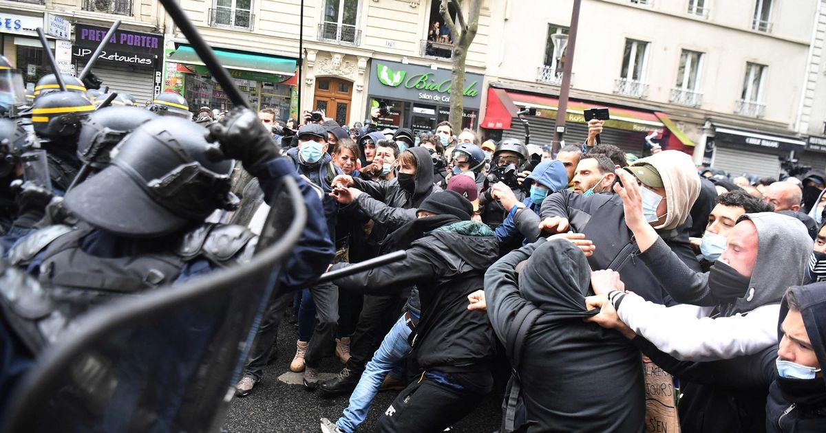 Protesters attack police with missiles as May Day marches descend into violence