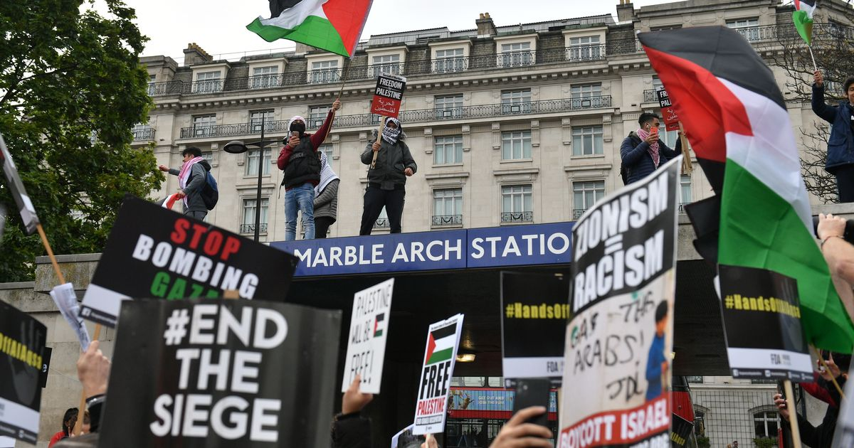 Thousands of people marching through London in protest