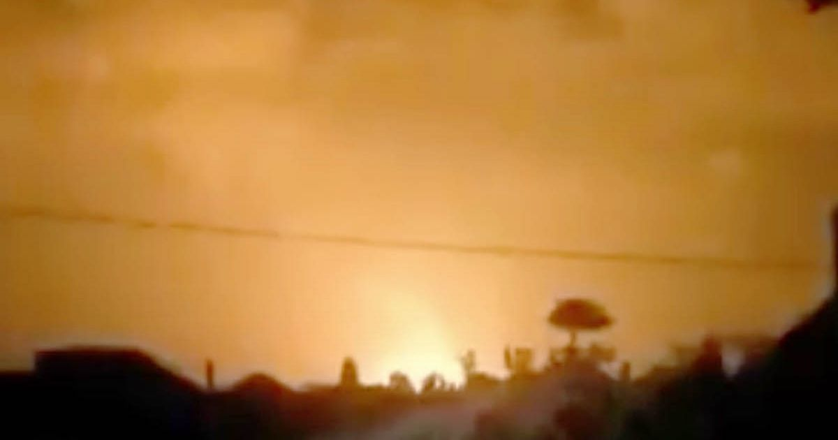 Volcano erupts with 'fountains' of lava expected to flow into city
