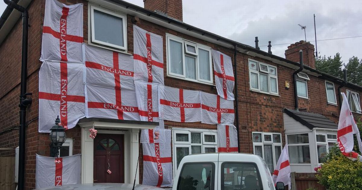 Footie fan who covered home in St Goerge's flags keeps them up despite threats