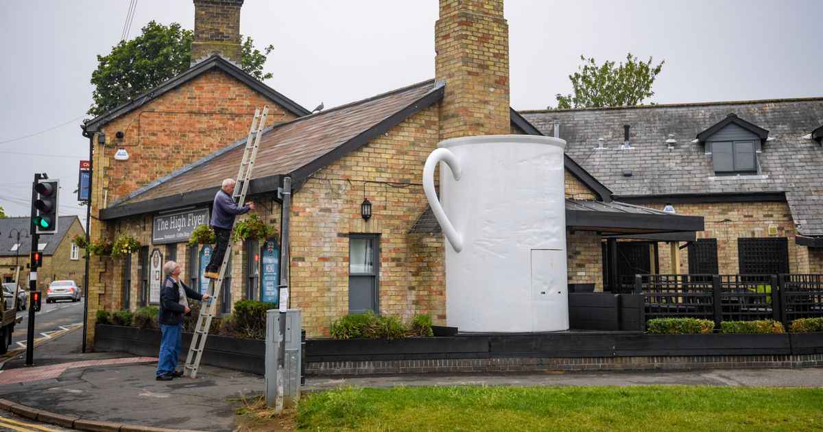 Pub landlords in hot water over installation of 12-foot-high coffee mug