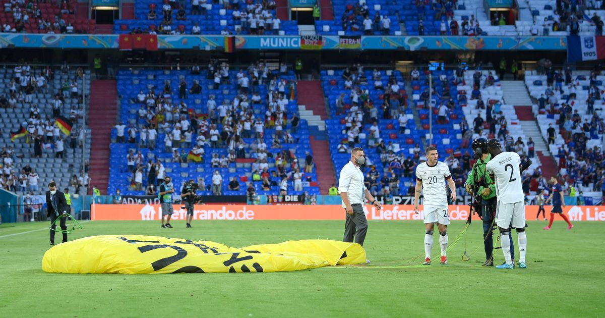 Several injured as Greenpeace protester parachutes into Euro 2020 match
