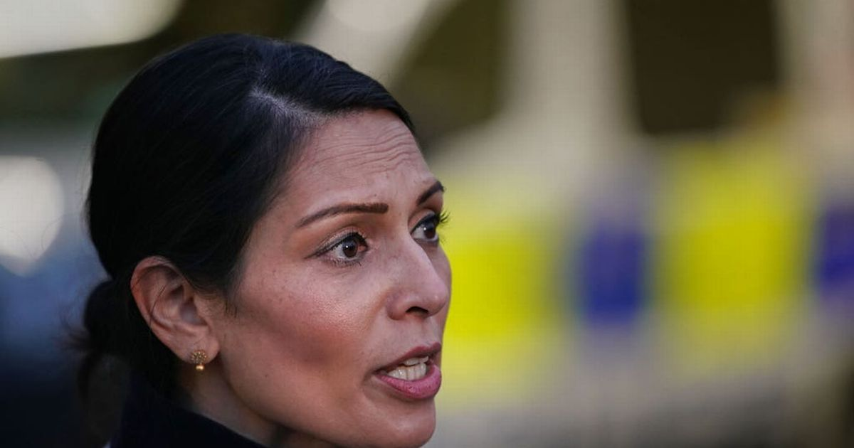 Two men charged over 'grossly offensive' message sent to Priti Patel
