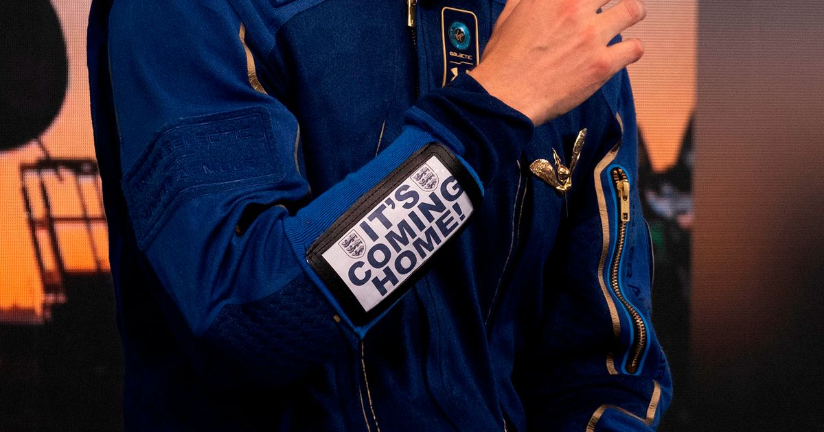 Astronaut on Branson's Galactic flight wears 'It's coming home' sign into space
