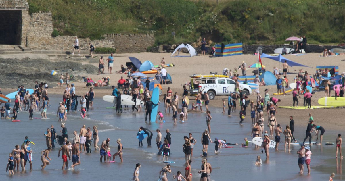 Body pulled from sea at busy beach