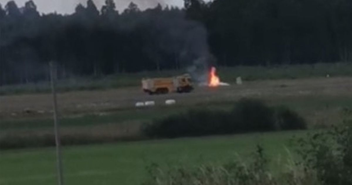 Plane carrying nine passengers crashes near airport as rescuers rush to scene