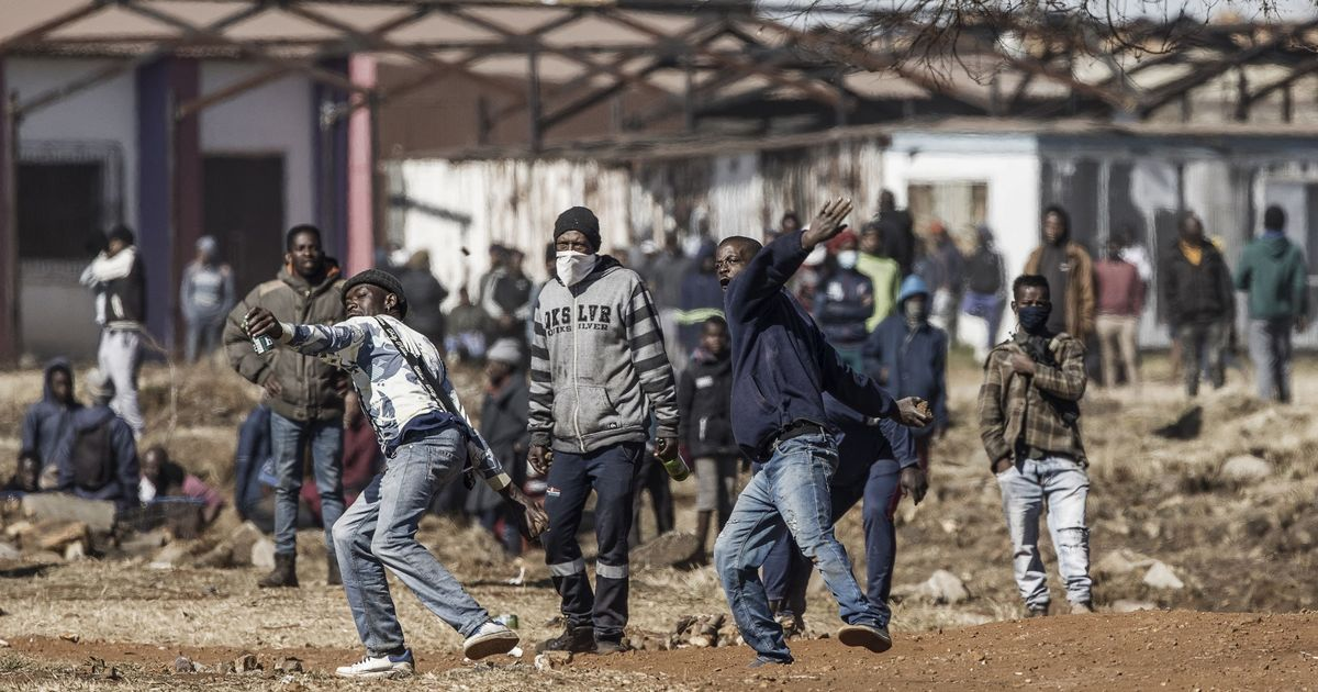 Riot mayhem sees 45 killed & woman throw baby from burning mall in South Africa