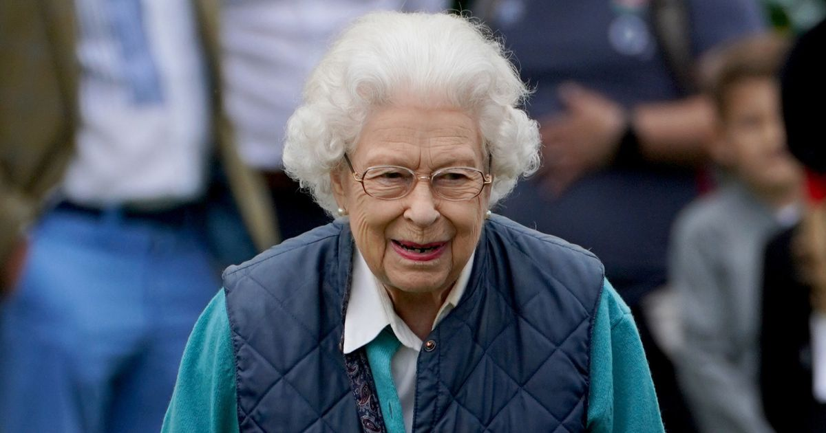 Smiling Queen in high spirits  at horse show