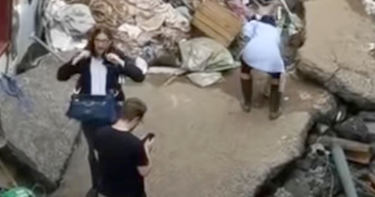 TV journalist suspended after 'rubbing mud on her face' in flood clean-up report