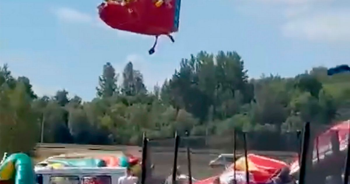 Terrified children hurled off bouncy castles as it's swept 30ft into the air