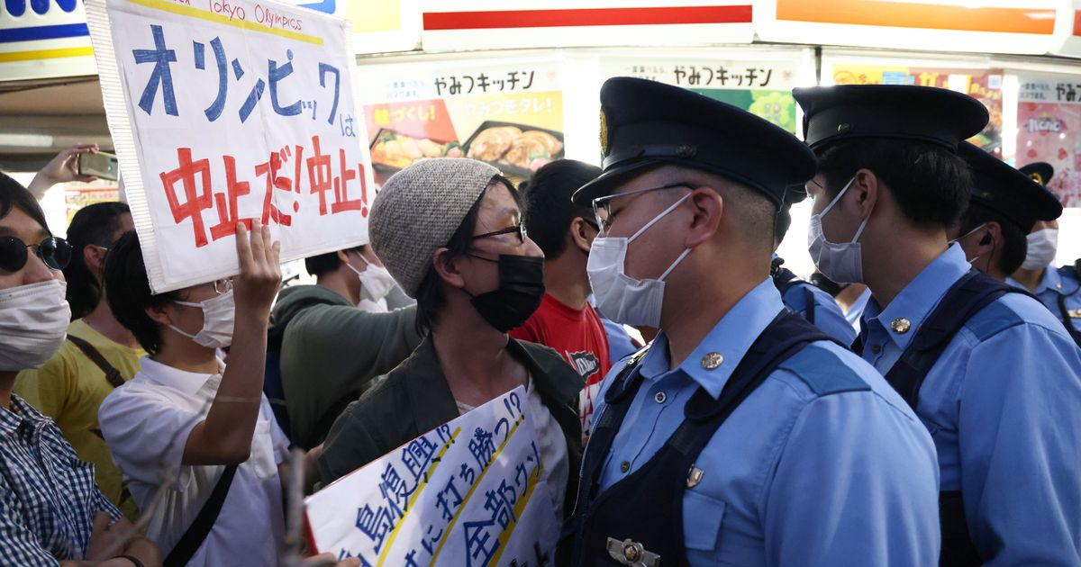 Tokyo Olympics protests as activists lock down streets before opening ceremony