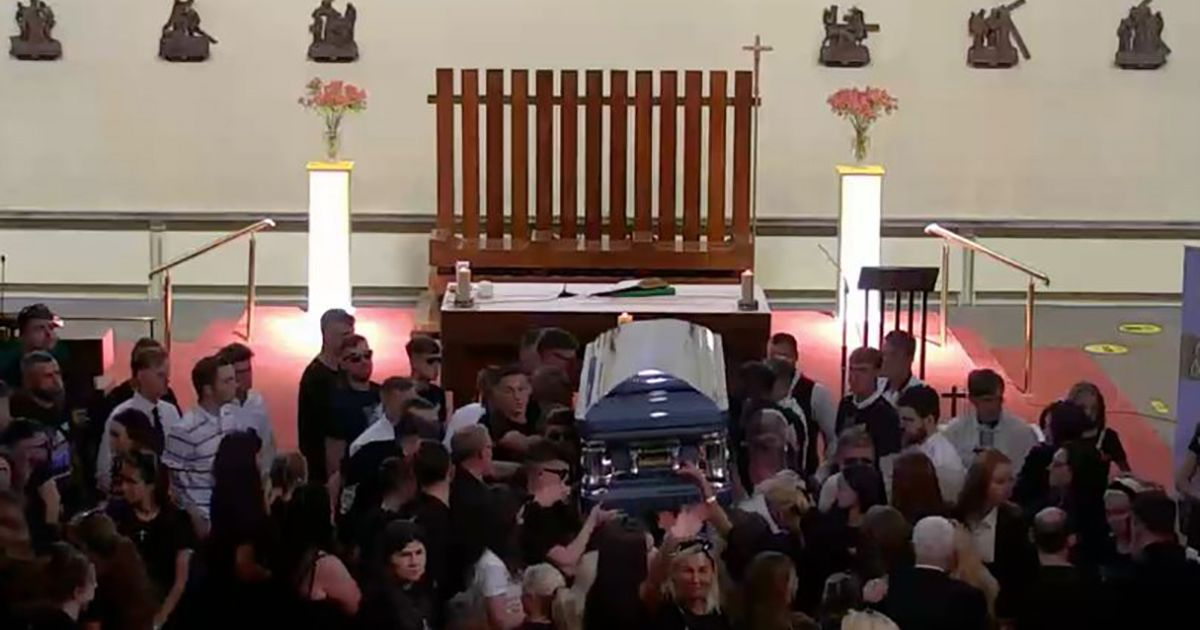 Tools and torch laid at altar during funeral of burglar killed in police chase