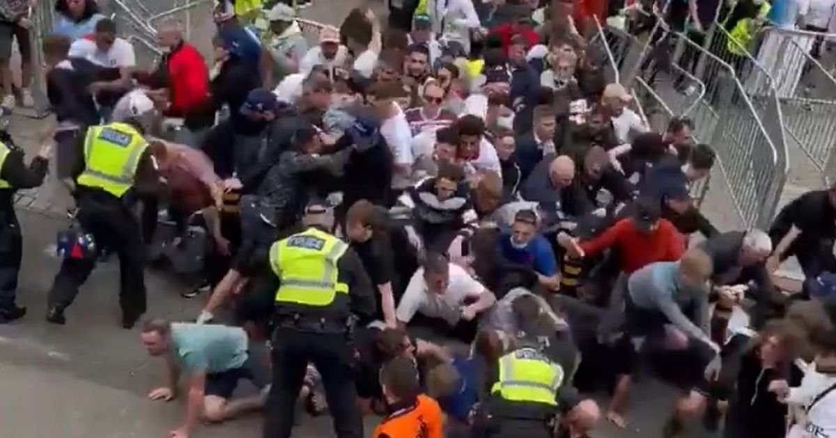 Two arrested on suspicion of helping England fans storm Wembley for Euros final