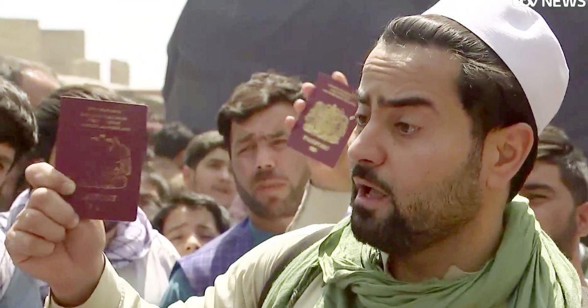 Children left 'stranded in Kabul' as Brit waves passport and begs PM to help