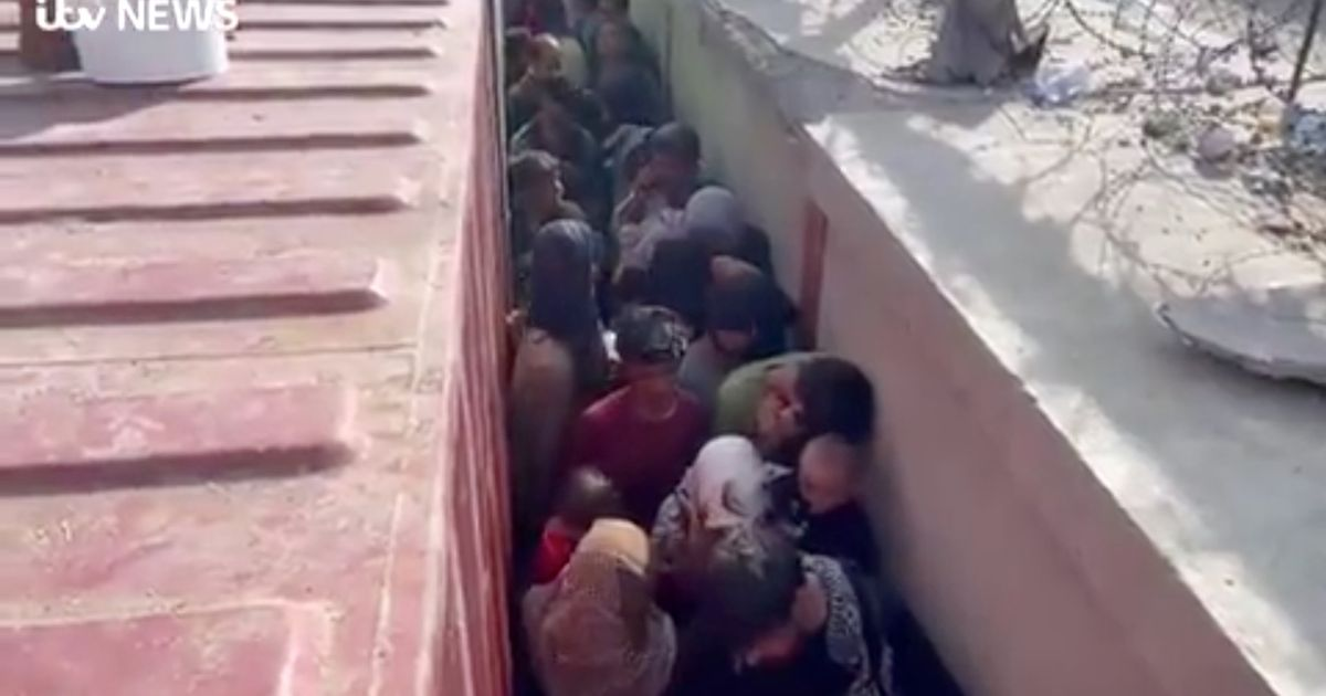 People queue at the airport