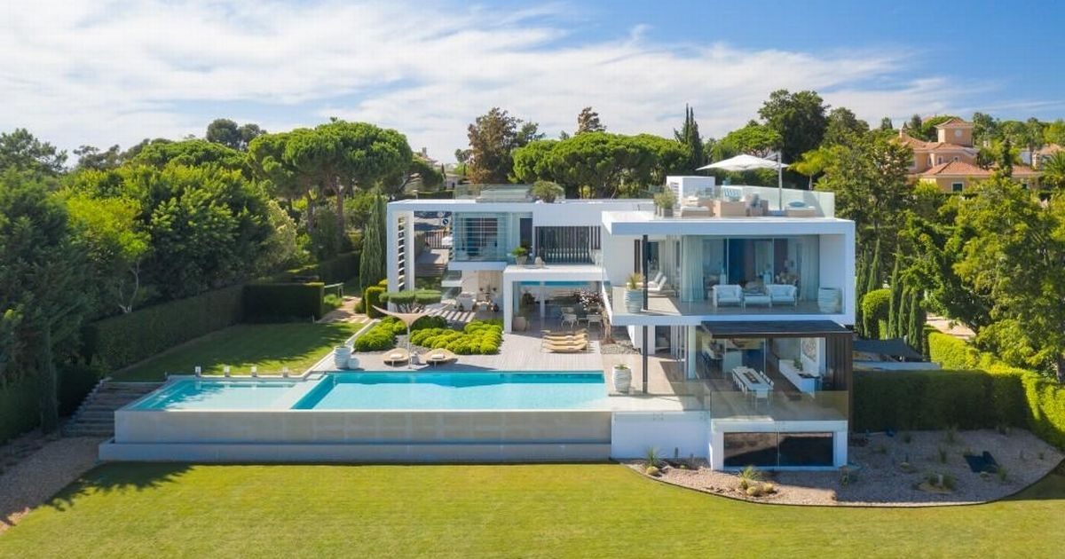 This villa in the Algarve has over 10,000 square feet of space and beautiful sea and lake views