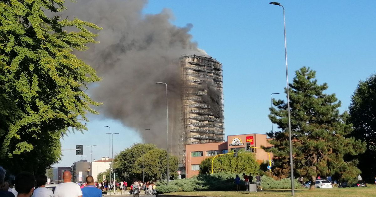 Milan fire: 18-story block of flats erupts in flames during search for people trapped