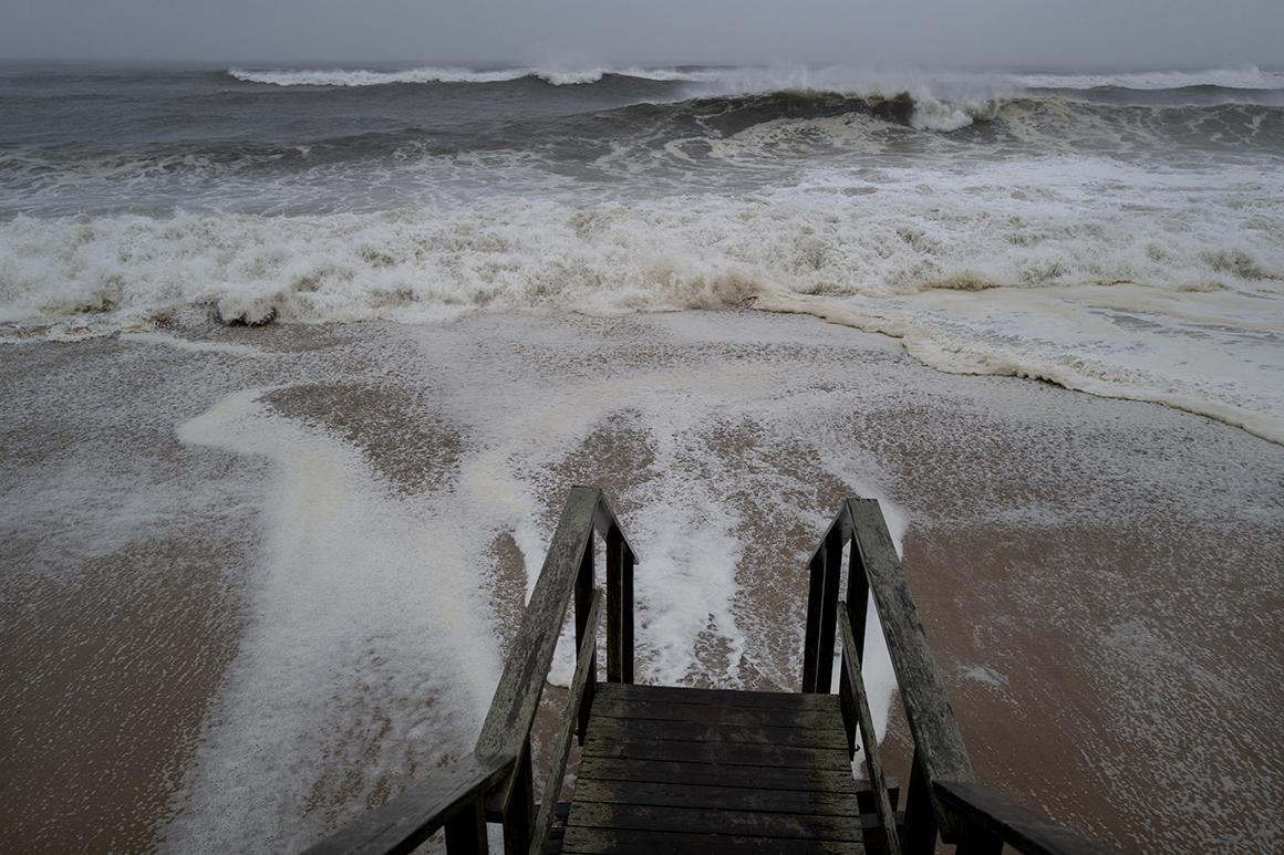 Moving inland, Tropical Storm Henri drenches Northeast