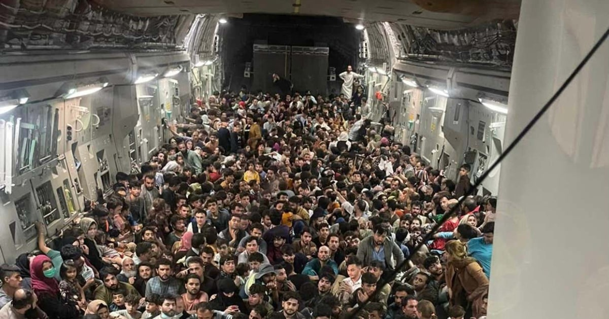 Packed in to get out: Photo shows hundreds crowded onto U.S. cargo jet