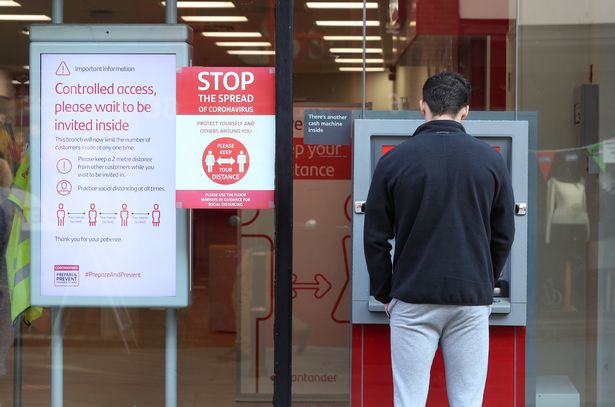A customer at an ATM outside Santander in Worcester High Street