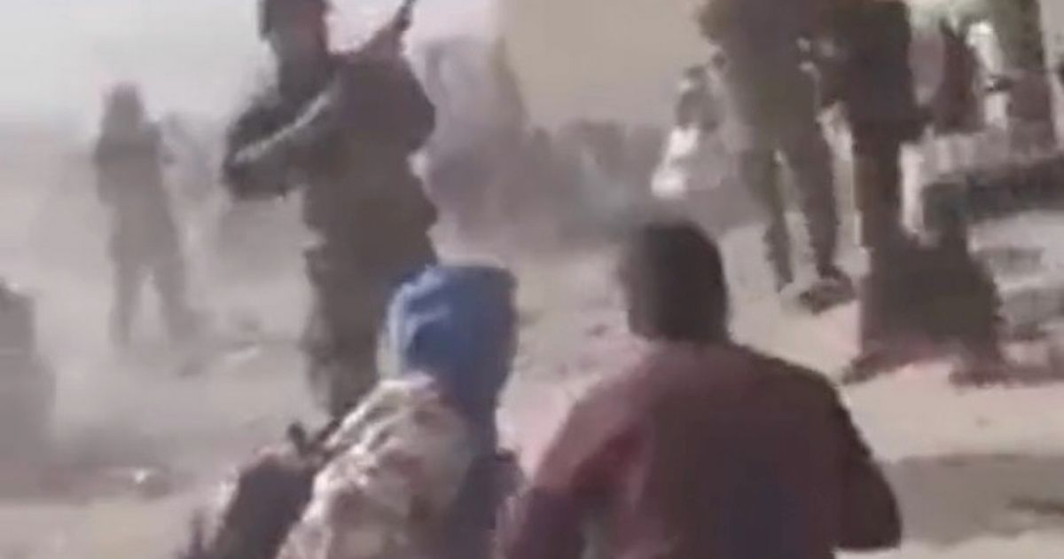 Video appears to show Taliban fighters opening fire against a crowd at the airport