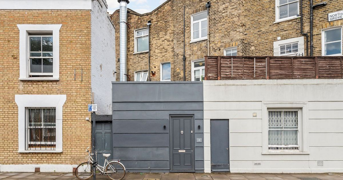 Small house up for sale could be mistaken for a shed but is surprisingly spacious inside