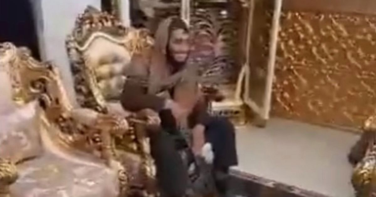 Taliban fighters lounge around in warlord's lavish gold palace after he flees