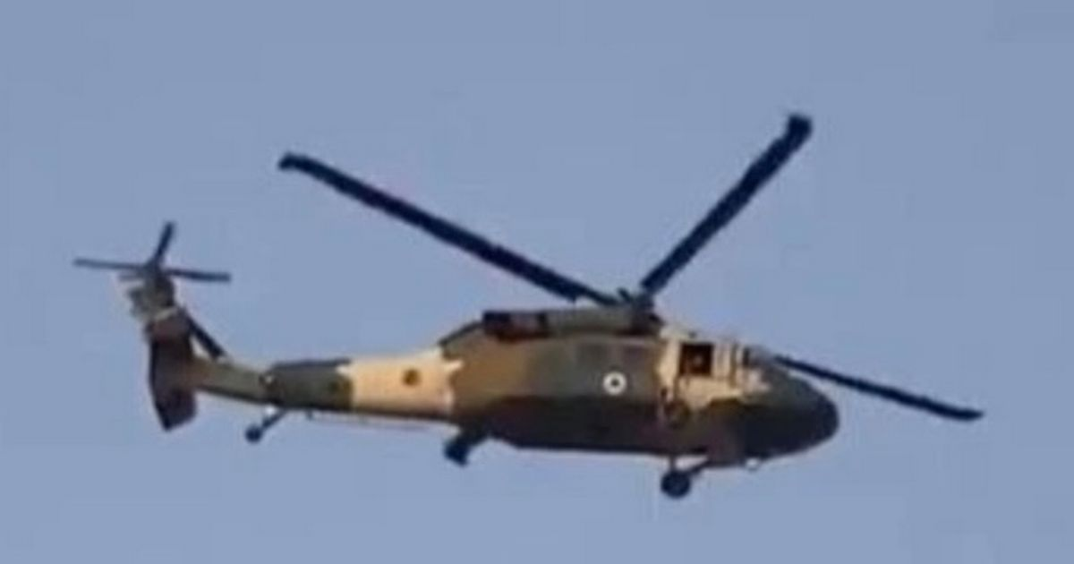 Taliban flies UK Black Hawk helicopter over city as man dangles from rope below