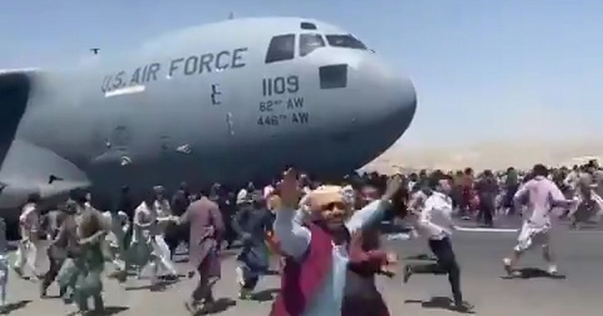 Afghans clung to a US military plane as it took off from Kabul