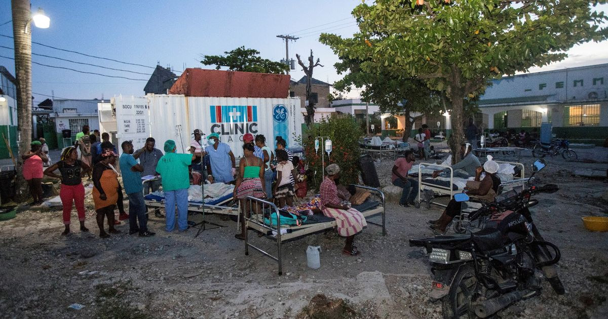 Terrified Haitians sleep in streets after earthquake as tropical storm moves in
