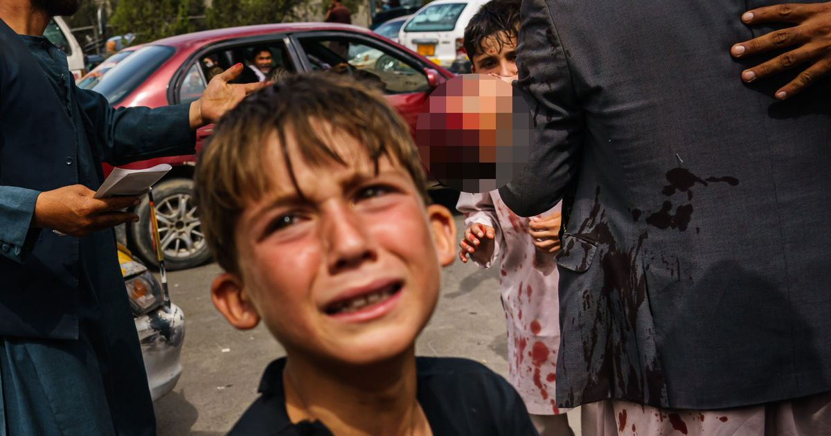 Terrified boy sobs near blood-stained child as Taliban beat families fleeing to airport