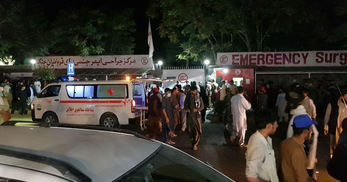 Injured people being carried to a hospital following the deadly blast