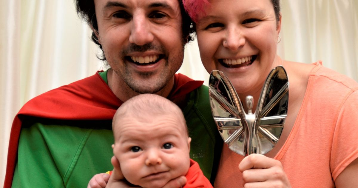 Jamie McDonald and partner Anna McDuff show off his Pride of Britain award with baby Storm