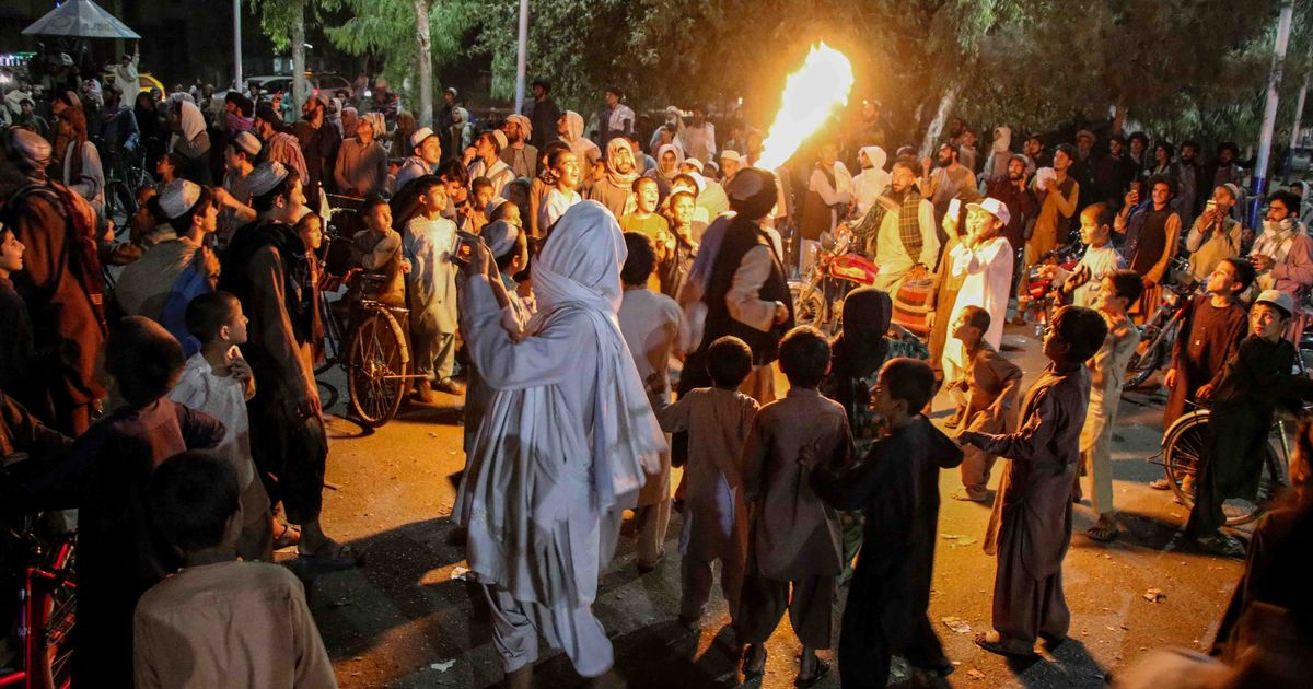 People celebrate the withdrawal of US forces in Kandahar, Afghanistan