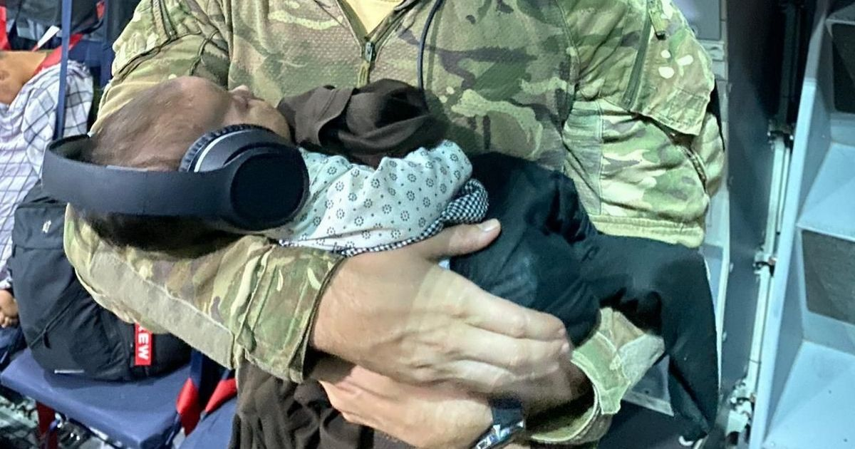 RAF hero holds baby on last flight from Kabul after exhausted mum drops her