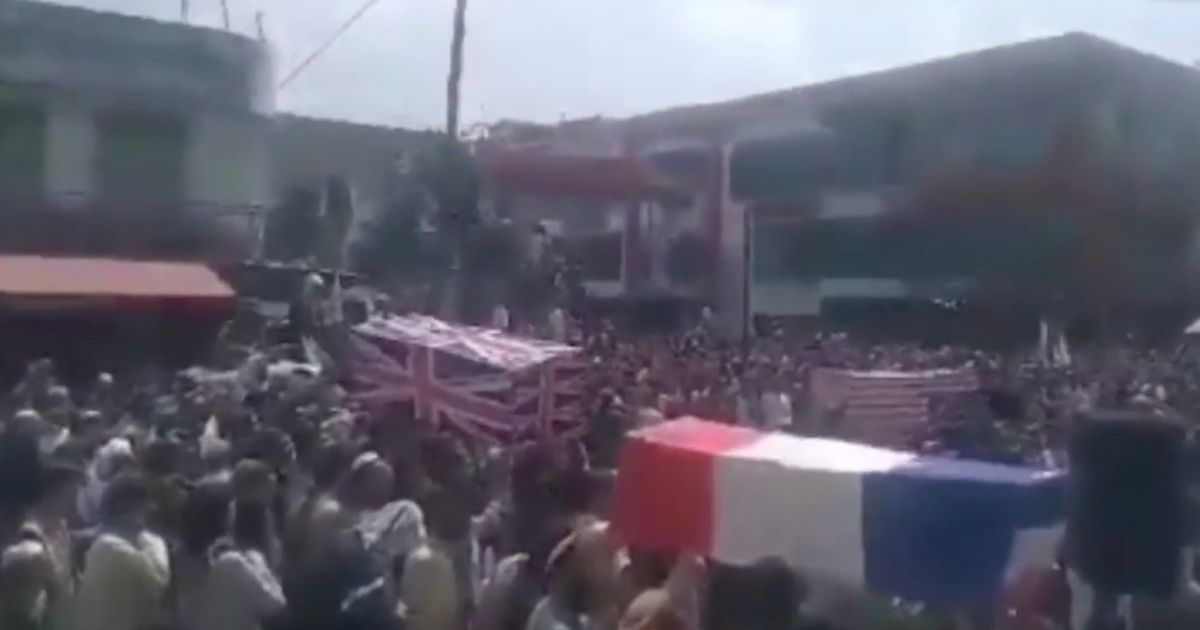 Taliban hold mock funerals with British and US coffins carried through streets