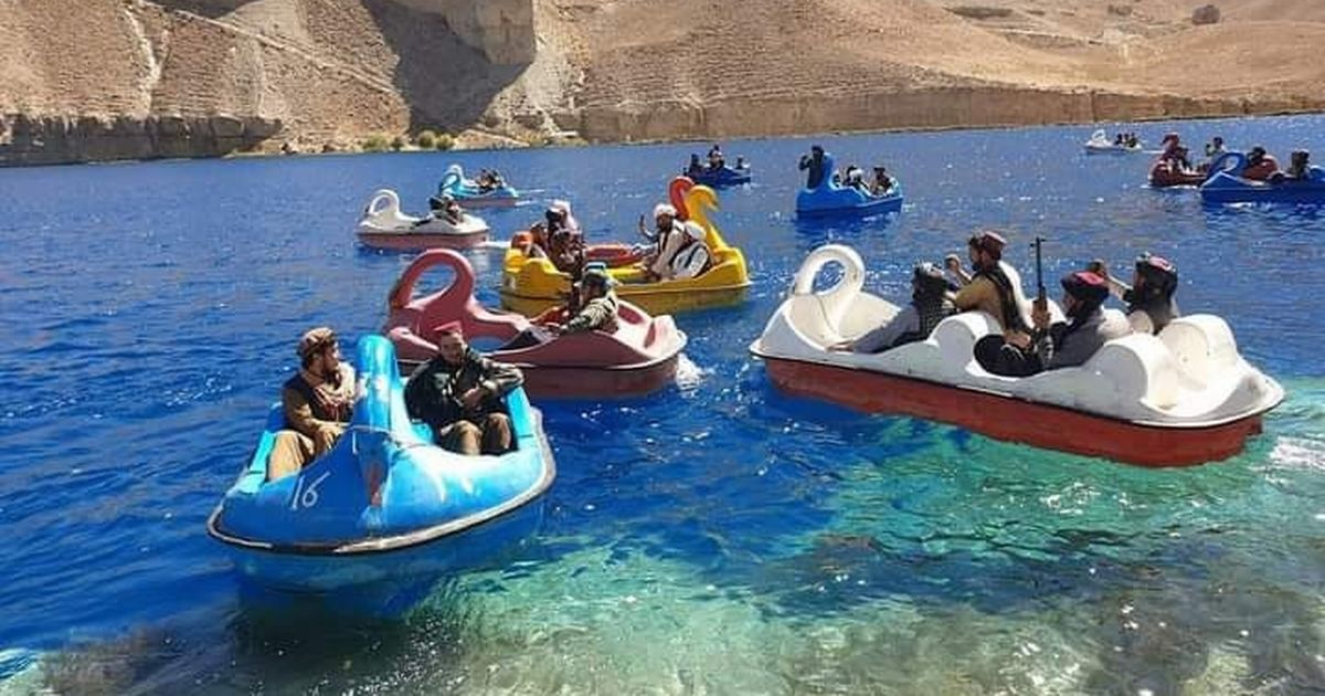 Armed Taliban soldiers spotted enjoying the sun on flamingo pedal boats