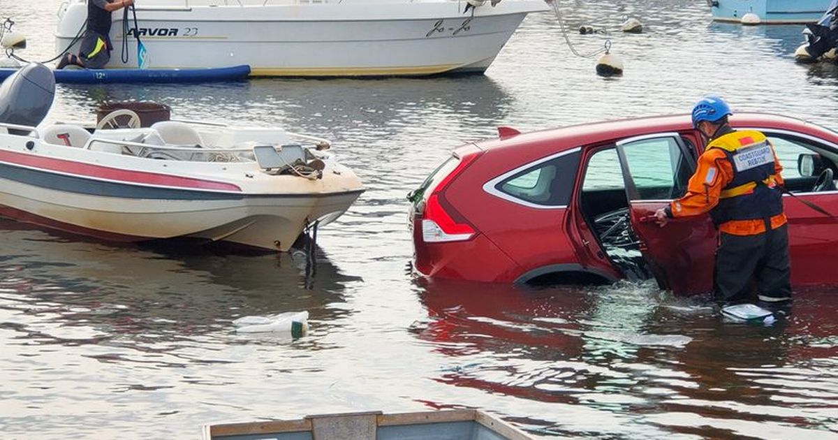 Driver swims to safety after car dragged into harbour by tide