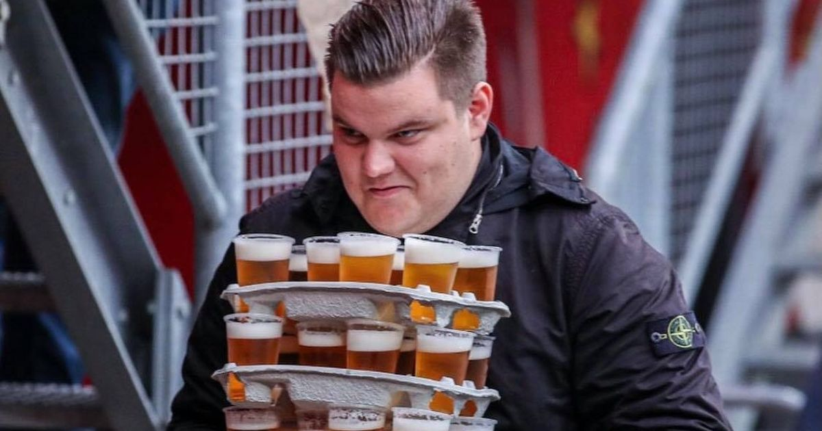 Football fan hailed a hero as he carries 48 beers in one trip and doesn't spill a drop