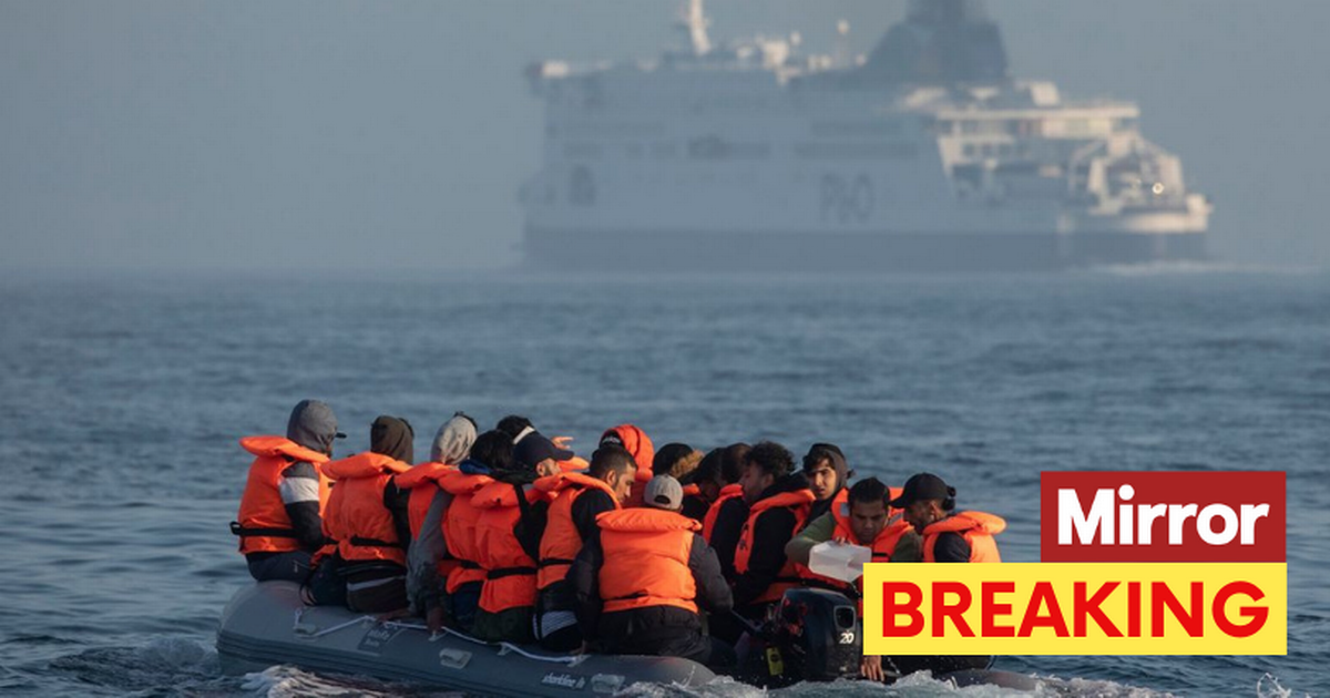 French police open fire at migrants' dinghy trying to stop it reaching the UK