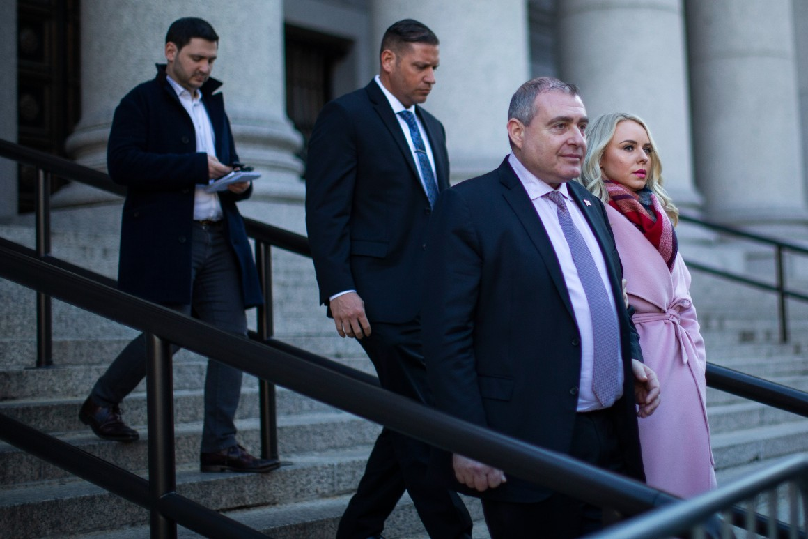 Lawyers wrangle over talk of Trump at trial of Giuliani associate