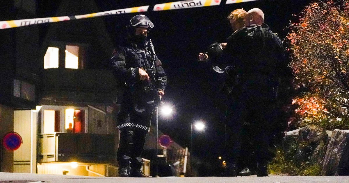 Police officers cordon off the scene where they are investigating in Kongsberg